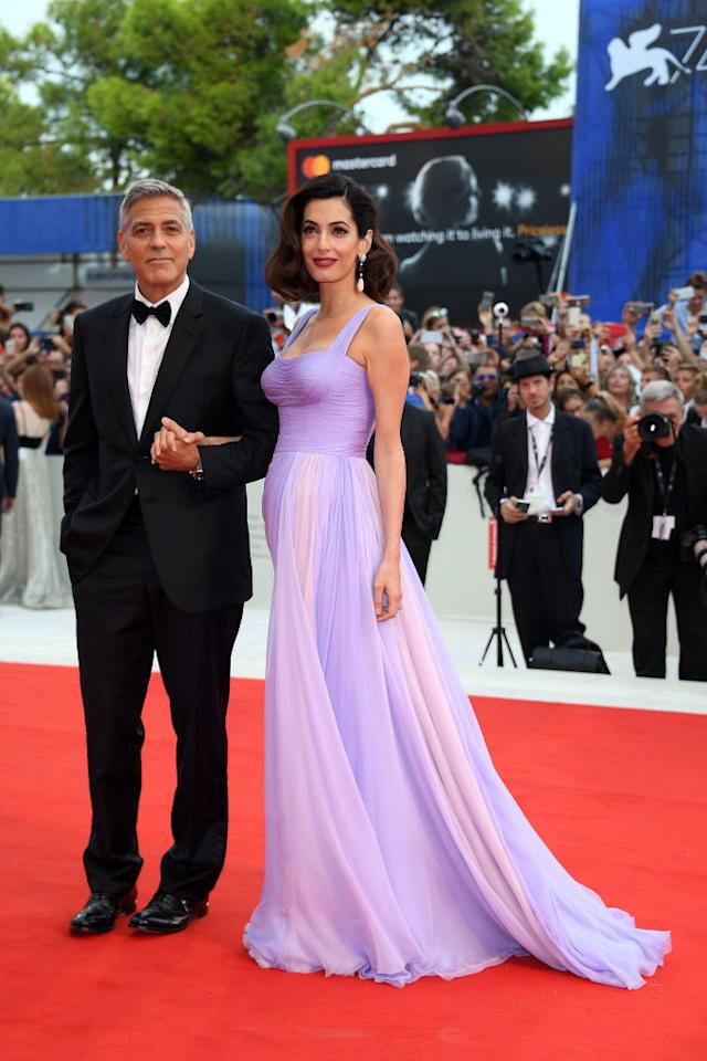 <p>All eyes were on Amal Clooney at the 74th Venice Film Festival, as she made her debut as new mum to twins. And she stunned the crowds in a lilac-hued dress by Versace. She finished the look with a Hollywood-worthy makeshift bob and bold lip. While George reminded us why he's the ultimate heartthrob in a tuxedo worthy of the red carpet. <em>[Photo: Getty]</em> </p>
