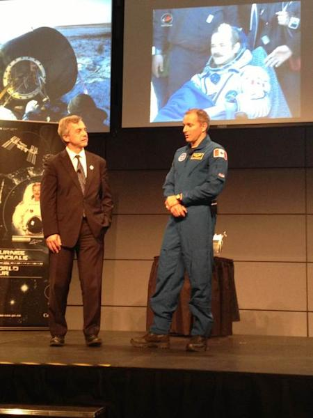 Former astronaut Robert Thirsk (left) and astronaut trainee David Saint-Jacques describe the Expedition 35 landing for tweetup attendees at Canadian Space Agency headquarters near Montreal.