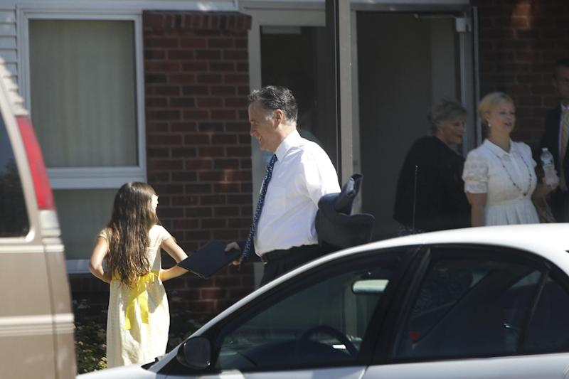 In a photo made July 1, 2012, Republican presidential candidate Mitt Romney arrives at The Church of Jesus Christ of Latter-Day Saints in Wolfeboro, N.H. Romney, the first Mormon to clinch the presidential nomination of a major party, attended services Sunday with his wife, Ann, five sons, five daughters-in-law and eighteen grandchildren. (AP Photo/Charles Dharapak)
