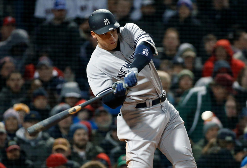 New York Yankees' Aaron Judge hits a solo home run during the fifth inning of a baseball game against the Boston Red Sox in Boston, Tuesday, April 10, 2018. (AP Photo/Michael Dwyer)
