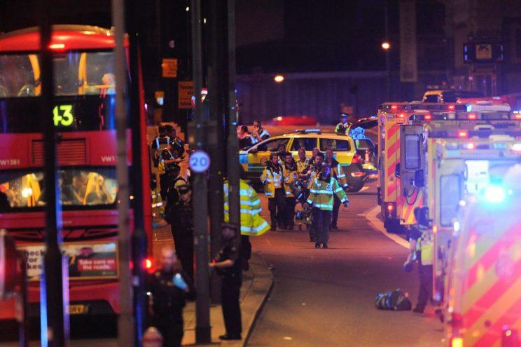 Emergency service workers attend to persons injured in an apparent terror attack on London Bridge