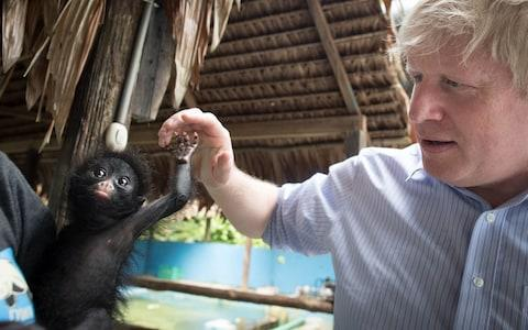 Boris Johnson meets a black spider monkey