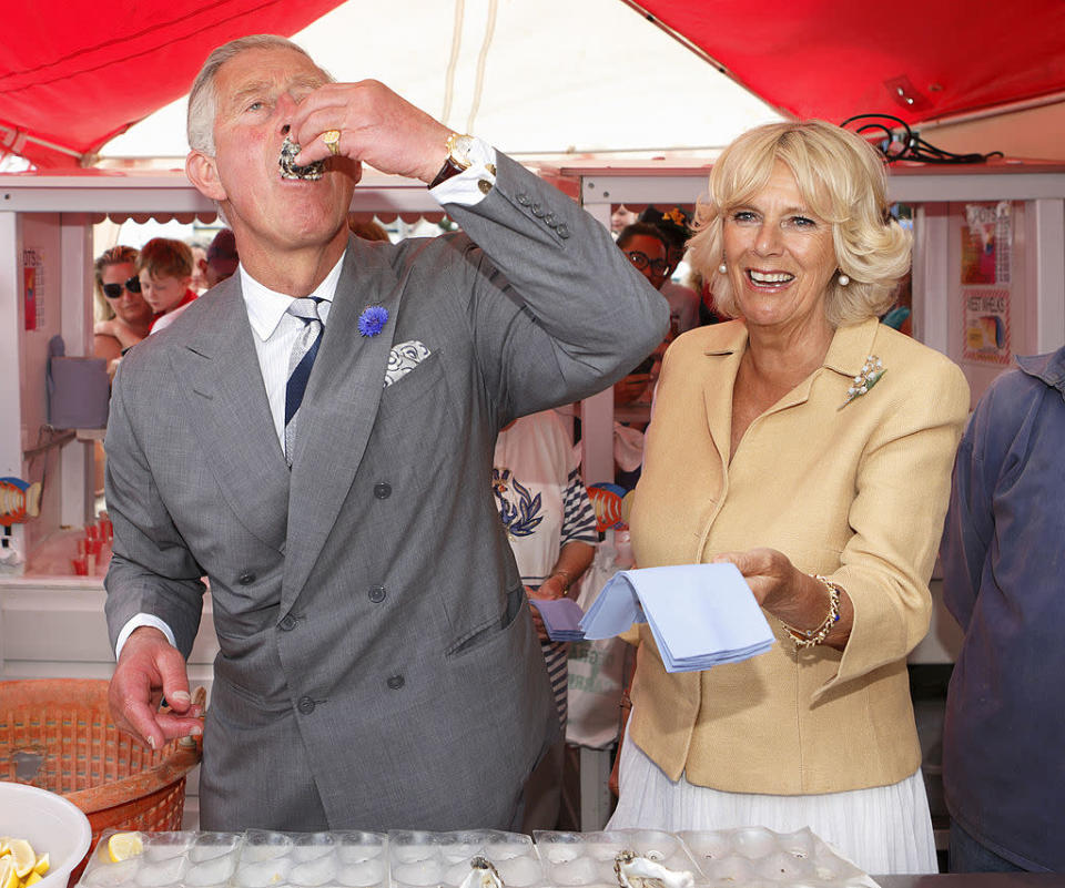 <p>Historically, members of the British royal family were advised not to eat shellfish to avoid getting sick. Oysters, clams, and mussels, for example, may contain marine toxins that can lead to food poisoning — although that didn't stop Prince Charles from sampling oysters at the Whitstable Oyster Festival! (Photos: Getty Images) </p>