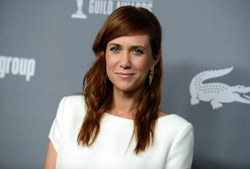 "FILE - This Feb. 19, 2013 file photo shows former ""Saturday Night Live,"" cast member Kristen Wiig at the 15th Annual Costume Designers Guild Awards at The Beverly Hilton Hotel in Beverly Hills. NBC announced Friday that Wiig will host the May 11 episode. For six seasons, Wiig was one of the most popular cast members on ""SNL"" before exiting in an emotional finale last year. Vampire Weekend will perform as musical guest. The network also announced that the season finale on May 18 will be hosted by Ben Affleck, with Kanye West as the musical guest. It's Affleck's fifth time hosting.  (Photo by Jordan Strauss/Invision/AP, file)"