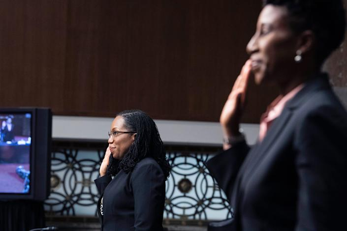 Candace Jackson-Akiwumi, nominated to be a judge on the U.S. Court of Appeals for the 7th Circuit, right, and Judge Ketanji Brown Jackson, nominated to the D.C. Circuit, are sworn in during a Senate Judiciary Committee hearing April 28.