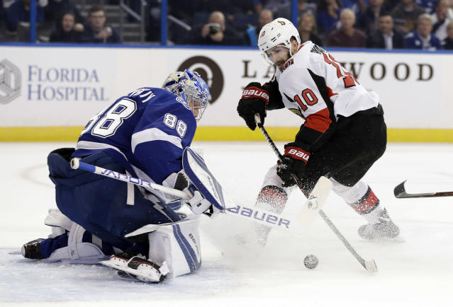 Tampa Bay Lightning goaltender Andrei Vasilevskiy, (88) of Russia, stops a shot by Ottawa Senators left wing Tom Pyatt (10) during the first period of an NHL hockey game Tuesday, March 13, 2018, in Tampa, Fla. (AP Photo/Chris O'Meara)