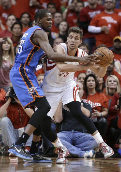 Houston Rockets' Chandler Parsons (25) looks to pass the ball around Oklahoma City Thunder's Kevin Durant (35) in the second quarter of Game 6 in a first-round NBA basketball playoff series Friday, May 3, 2013, in Houston. (AP Photo/Pat Sullivan)