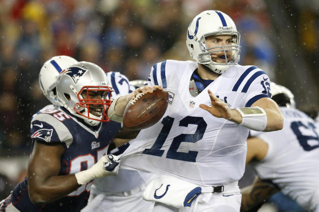 New England Patriots defensive end Chandler Jones (95) grabs the jersey of Indianapolis Colts quarterback Andrew Luck (12) as Luck looks for an opening to pass during the first half of an AFC divisional NFL playoff football game in Foxborough, Mass., Saturday, Jan. 11, 2014. (AP Photo/Michael Dwyer)