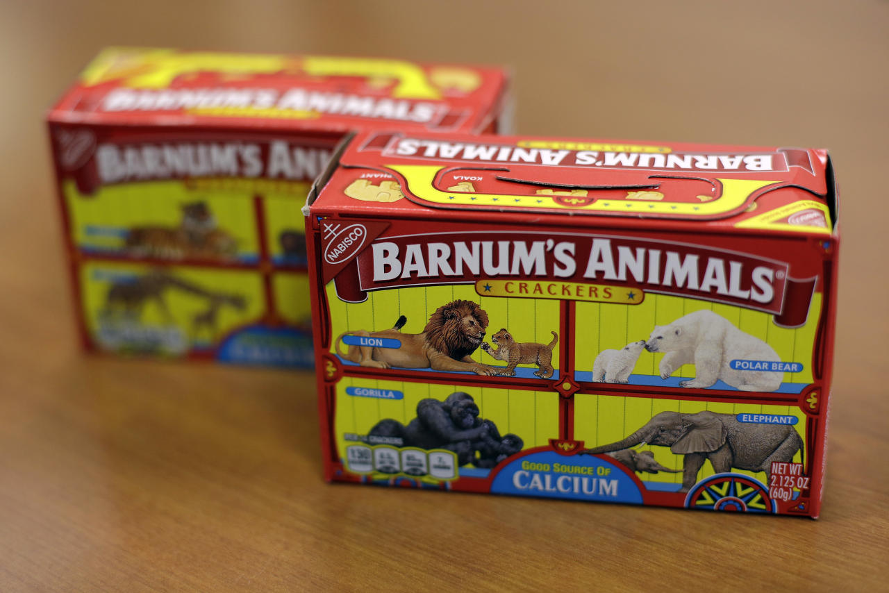 "This Monday, Aug. 20, 2018, photo shows boxes of Nabisco's Barnum's Animals crackers in Chicago. After more than a century behind bars, the beasts on boxes of animal crackers are roaming free. The new boxes retain their familiar red and yellow coloring and prominent ""Barnum's Animals"" lettering. But instead of showing the animals in cages, implying that they're traveling in boxcars for the circus, the new boxes feature a zebra, elephant, lion, giraffe and gorilla wandering side-by-side in a grassland. (AP Photo/Kiichiro Sato)"
