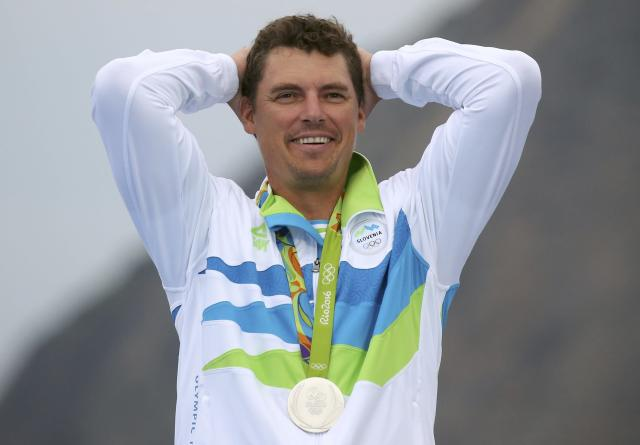 2016 Rio Olympics - Sailing - Victory Ceremony - Men's One Person Dinghy (Heavyweight) - Finn - Marina de Gloria - Rio de Janeiro, Brazil - 16/08/2016. Vasilij Zbogar (SLO) of Slovenia reacts with his medal. REUTERS/Benoit Tessier FOR EDITORIAL USE ONLY. NOT FOR SALE FOR MARKETING OR ADVERTISING CAMPAIGNS.