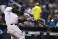 New York Yankees' Anthony Rizzo hits a solo home run during the sixth inning of the team's baseball game against the Miami Marlins, Friday, July 30, 2021, in Miami. (AP Photo/Lynne Sladky)