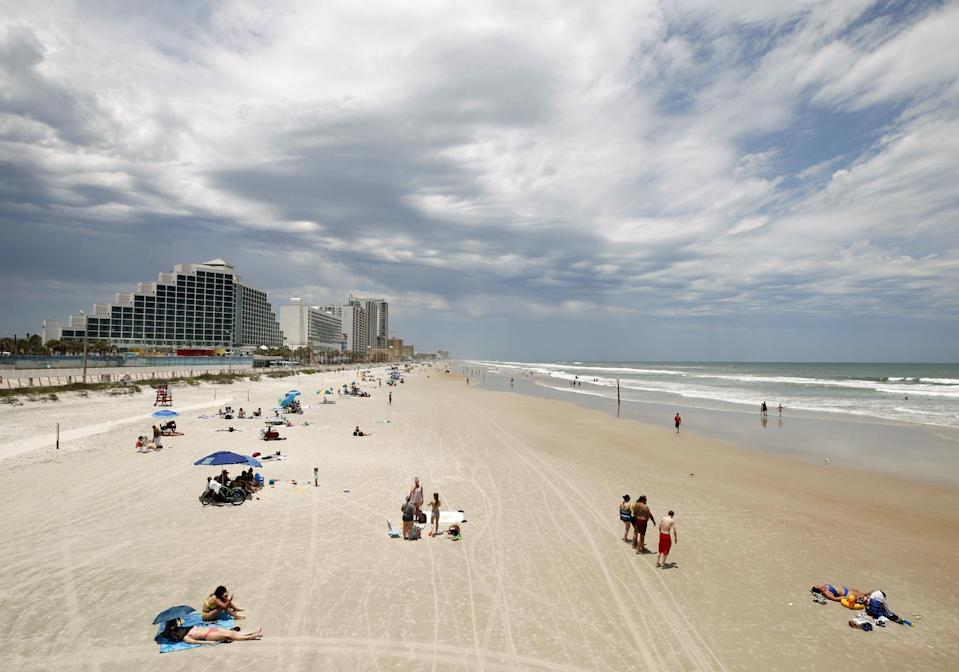 """Touted as the """"World's Most Famous Beach,"""" Daytona beckons sunbathers with its 23 miles of hard-packed, white-sand beaches."""