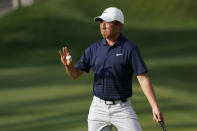 Doug Ghim waves after making a putt on the 14th hole during the third round of The Players Championship golf tournament Saturday, March 13, 2021, in Ponte Vedra Beach, Fla. (AP Photo/John Raoux)