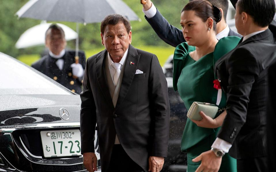 Duterte and his daughter arriving at an event - Carl Court/Pool via Reuters