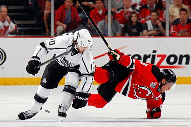 NEWARK, NJ - JUNE 09: Zach Parise #9 of the New Jersey Devils falls to the ice against Mike Richards #10 of the Los Angeles Kings during Game Five of the 2012 NHL Stanley Cup Final at the Prudential Center on June 9, 2012 in Newark, New Jersey.  (Photo by Bruce Bennett/Getty Images)