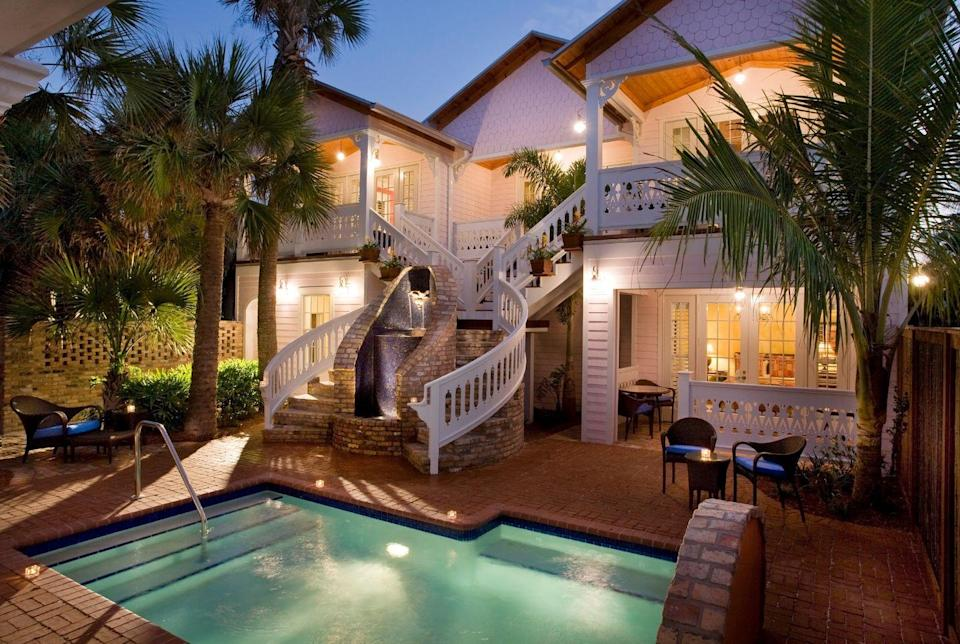 "<p>This amazing property is set just 200 feet from the Atlantic Ocean, about halfway down the coast of Florida. This 1916 home was carefully restored by its current owners to serve as a bed and breakfast, complete with tropical gardens, private courtyards, a pool, hot tub, and fire pit. </p><p>Not only is this highly awarded property home to thoughtfully curated rooms, but it also has a hefty list of amenities, like in-room massages, beach bikes and accessories, and a fitness center. <a href=""https://www.portdhiver.com/"" rel=""nofollow noopener"" target=""_blank"" data-ylk=""slk:Port d'Hiver"" class=""link rapid-noclick-resp"">Port d'Hiver </a>is the perfect place to kick back and enjoy Old Florida charm on a quiet stretch of shoreline at any time of year. </p>"