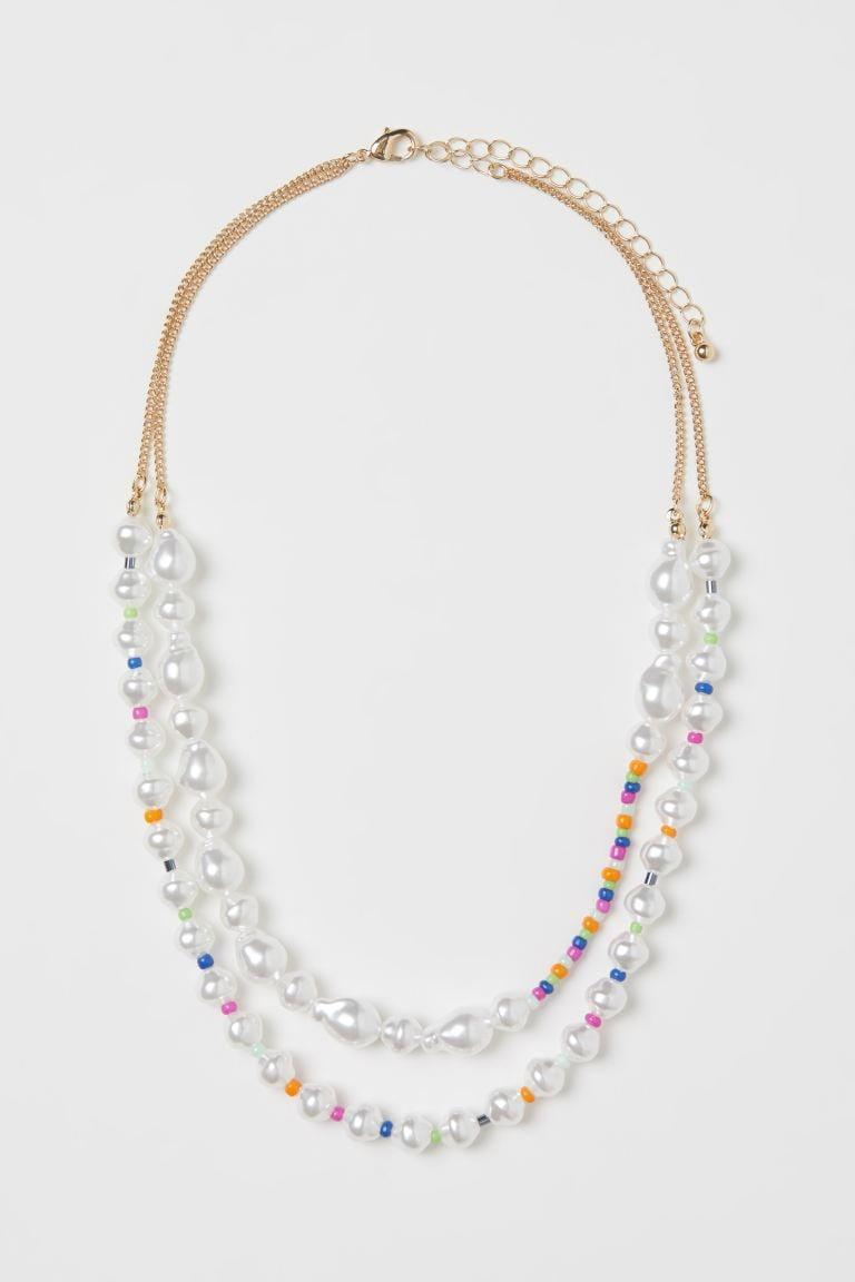 <p>Style this <span>Double-strand Necklace</span> ($10) with a round neckline sweater.</p>