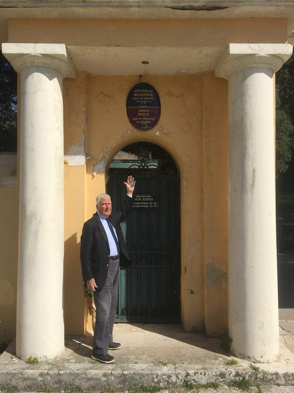 Count Spiro Flamburiari, chair of the Corfu Heritage Foundation, with the plaque dedicated to Prince Philip outside Mon ReposAlex Sakalis