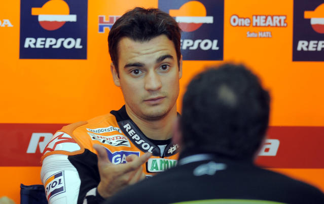 Repsol Honda Team's Spanish Dani Pedrosa is pictured in the pit during the Moto GP's second training session of Valencia's Grand Prix at Ricardo Tormo racetrack in Cheste, on November 04, 2011. AFP PHOTO / JOSE JORDAN (Photo credit should read JOSE JORDAN/AFP/Getty Images)