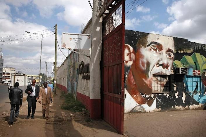 People walk near a street art by Bankslave and Swift depicting US President Barack Obama on July 15, 2015 at the Go Down Art Centre in Nairobi (AFP Photo/Till Muellenmeister)