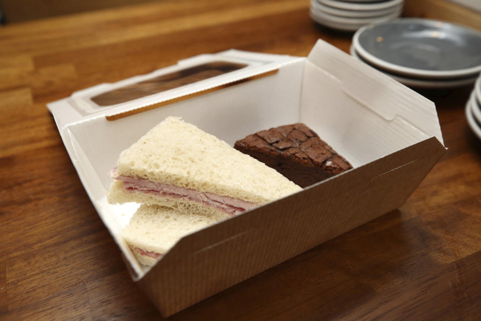 A view of a lunch box at the Pudding Pantry which they will be providing free, during half term for any child in need, who would normally get a free school lunch, after MPs voted to reject a motion to provide food to those in need during the school holidays, in Nottingham, England, Friday, Oct. 23, 2020. Pediatricians are urging the British government to reverse course and provide free meals for poor children during school holidays as the COVID-19 pandemic pushes more families into poverty. (Tim Goode/PA via AP)