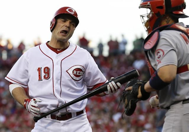 Cincinnati Reds' Joey Votto (19) reacts after striking out against St. Louis Cardinals starting pitcher Shelby Miller with runners in scoring position in the first inning of a baseball game, Wednesday, Sept. 4, 2013, in Cincinnati. Cardinals' Yadier Molina is at right. (AP Photo/Al Behrman)
