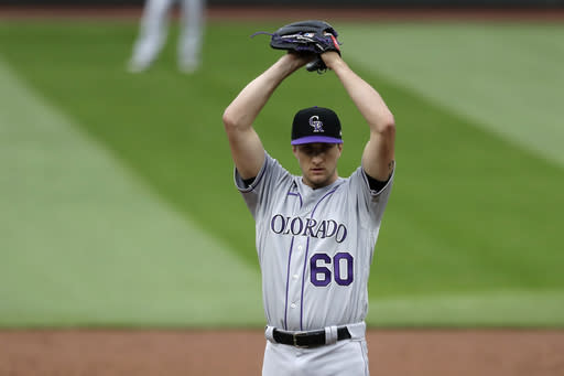 Colorado Rockies starting pitcher Ryan Castellani stretches before throwing against the Seattle Mariners in the third inning of a baseball game Saturday, Aug. 8, 2020, in Seattle. (AP Photo/Elaine Thompson)