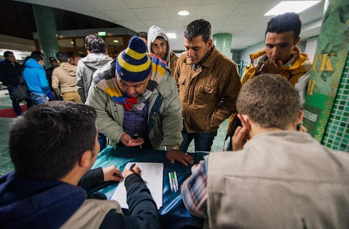 Asylum seekers register at Stockholm central mosque on October 15, 2015 after a long bus journey from the southern city of Malmo (AFP Photo/Jonathan Nackstrand)