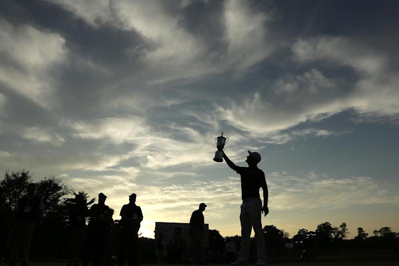 Justin Rose, of England, poses with the trophy after winning the U.S. Open golf tournament at Merion Golf Club, Sunday, June 16, 2013, in Ardmore, Pa. (AP Photo/Charlie Riedel)