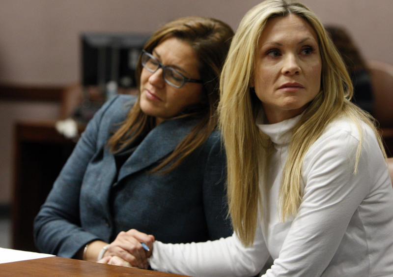 "FILE - This Nov. 27, 2012 file photo shows attorney Ellen Torregrossa-O'Connor, left, holding the hand of former ""Melrose Place"" actress Amy Locane-Bovenizer, 40, of Hopewell Township, N.J. as the jury in her trial returns a verdict in Somerville, N.J. Locane-Bovenizer, who was driving drunk when her SUV plowed into a car and killed a New Jersey woman, was sentenced Thursday, Feb. 14, 2013, to three years in prison. (AP Photo/The Star-Ledger, Robert Sciarrino, filel)"