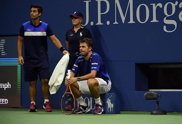 Stan Wawrinka of Switzerland sits after missing a point against Roger Federer of Switzerland during their 2015 US Open Men's Singles semifinals at the USTA Billie Jean King National Tennis Center on September 11, 2015 in New York. AFP PHOTO / TIMOTHY A. CLARY (AFP Photo/TIMOTHY A. CLARY)