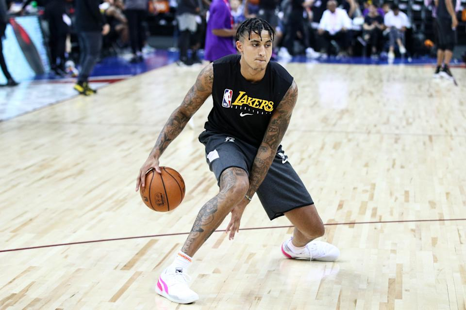 After hurting his left foot with Team USA this summer, Kyle Kuzma will miss the Lakers' season opener this week.
