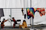 Children play with stones at an Afghan refugees camp on Joint Base McGuire Dix Lakehurst, N.J., on Monday, Sept. 27, 2021. The camp currently holds about 9,400 Afghan refugees and has a capacity to hold up to 13,000. (AP Photo/Andrew Harnik)
