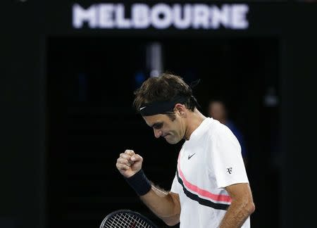 Roger Federer of Switzerland celebrates winning against Aljaz Bedene of Slovenia. REUTERS/Thomas Peter
