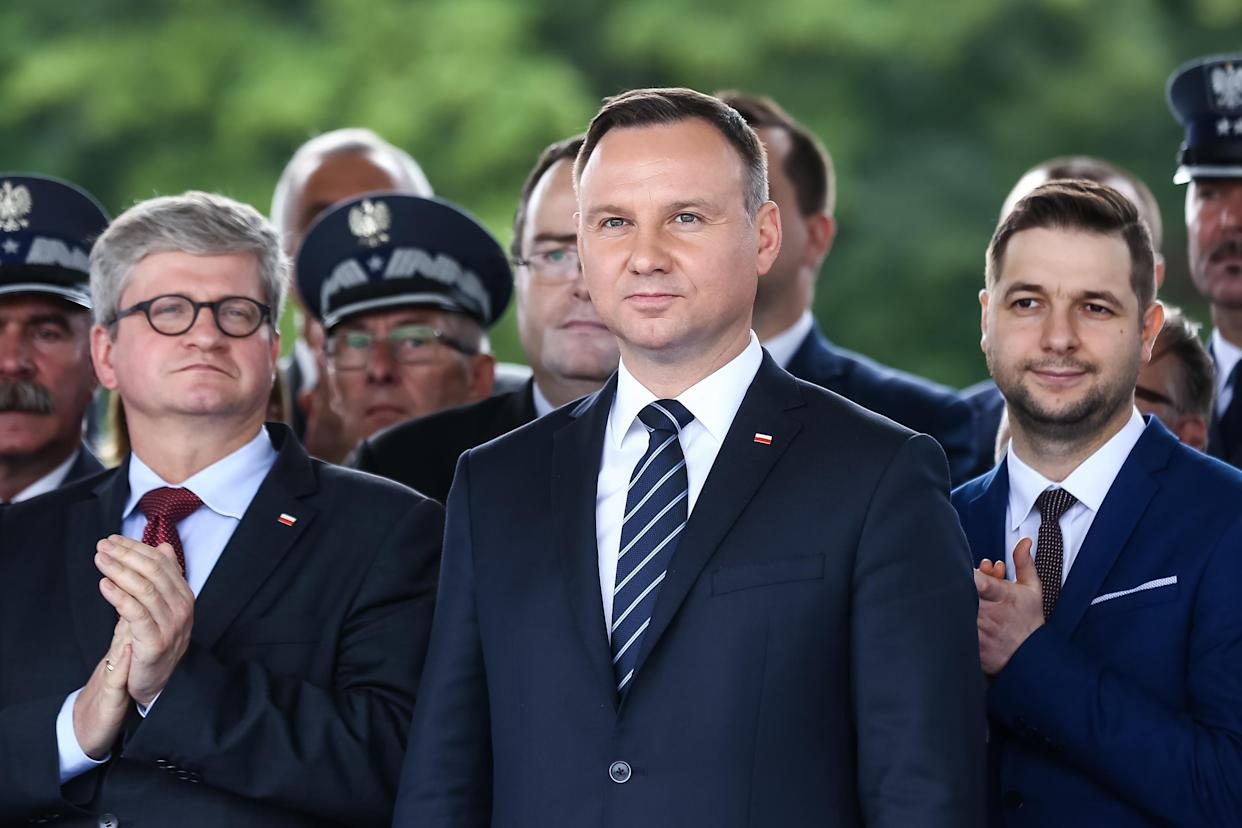 Polish President Andrzej Duda, center; Pawel Soloch,head of the national security office, left; Patryk Jaki, first deputy minister of justice, right, and others participate in the Central Celebrations of the Prison Service in Poland on June 30, 2017, in Warsaw, Poland. (Photo: Karol Serewisi/Gallo Images Poland/Getty Images)