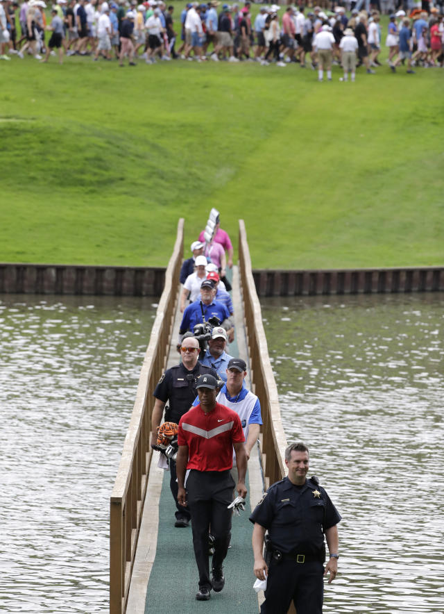 Tiger Woods, center, walks to the 13th green during the final round of the BMW Championship golf tournament at Medinah Country Club, Sunday, Aug. 18, 2019, in Medinah, Ill. (AP Photo/Nam Y. Huh)