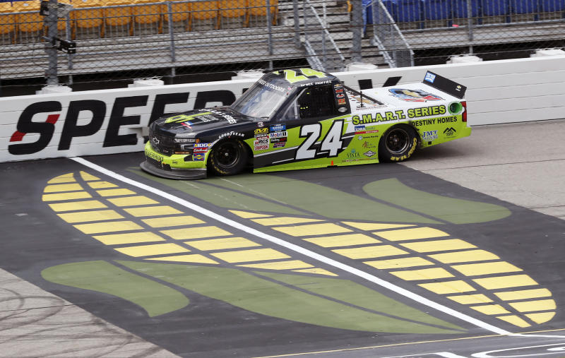 Brett Moffitt races his truck during the NASCAR Truck Series auto race, Sunday, June 16, 2019, at Iowa Speedway in Newton, Iowa. Moffitt was declared the winner of the race after apparent winner Ross Chastain's car failed a post-race inspection. (AP Photo/Charlie Neibergall)
