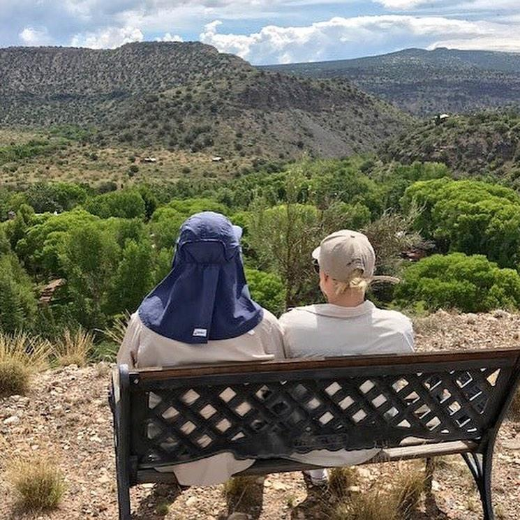 A photo of Meghan McCain and Sen. John McCain sitting together and looking out over an Arizona hillside | Meghan McCain/ Instagram