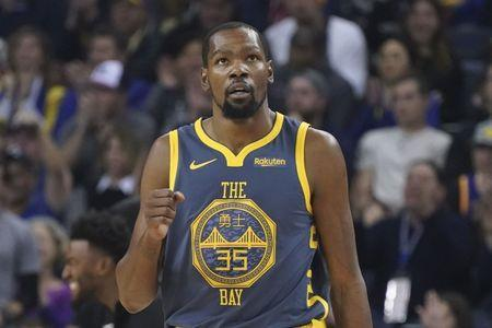 FILE PHOTO - November 24, 2018; Oakland, CA, USA; Golden State Warriors forward Kevin Durant (35) celebrates against the Sacramento Kings during the first quarter at Oracle Arena. Mandatory Credit: Kyle Terada-USA TODAY Sports