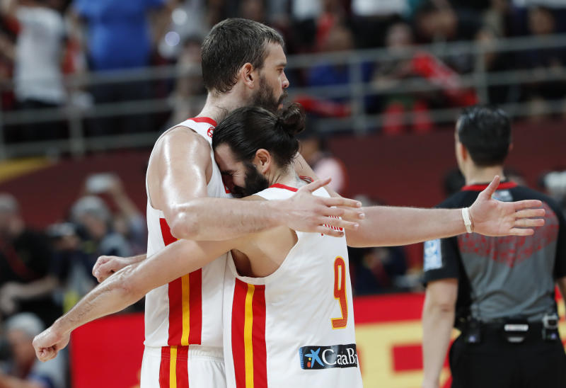 Basketball - FIBA World Cup - Semi Finals - Spain v Australia - Wukesong Sport Arena, Beijing, China - September 13, 2019 Spain's Marc Gasol and Ricky Rubio celebrate victory after the match REUTERS/Kim Kyung-Hoon