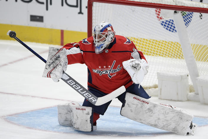 Washington Capitals goaltender Vitek Vanecek (41) stops the puck during the third period of an NHL hockey game against the Buffalo Sabres, Friday, Jan. 22, 2021, in Washington. (AP Photo/Nick Wass)