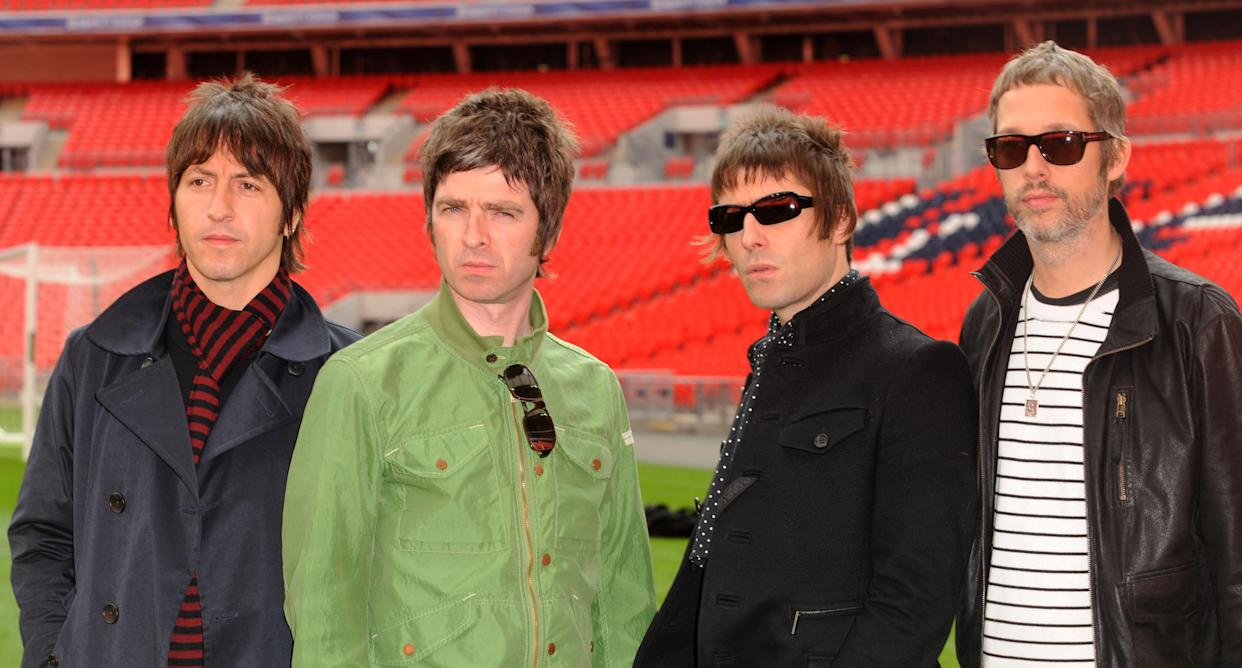 Oasis (from left to right) Gem Archer, Noel Gallagher, Liam Gallagher and Andy Bell are pictured during a photocall at Wembley Stadium, where they announced their biggest ever tour of open air venues in the UK and Ireland next summer.   (Photo by Zak Hussein - PA Images/PA Images via Getty Images)