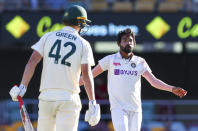 India's Mohammed Siraj, right, reacts after bowling to Australia's Cameron Green during play on the first day of the fourth cricket test between India and Australia at the Gabba, Brisbane, Australia, Friday, Jan. 15, 2021. (AP Photo/Tertius Pickard)