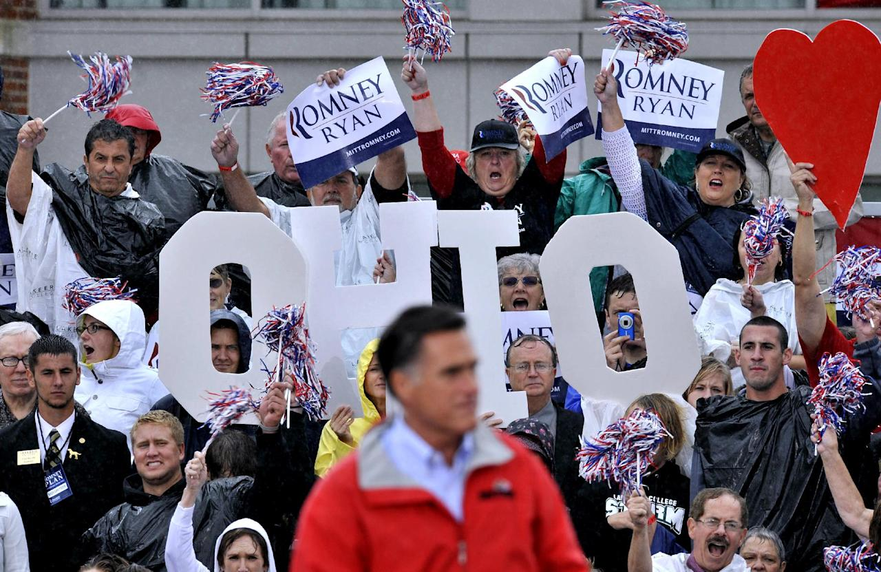 Supporters cheer as Republican presidential candidate, former Massachusetts Gov. Mitt Romney campaigns in the rain at Lake Erie College in Painesville, Ohio, Friday, Sept. 14, 2012. (AP Photo/David Richard)