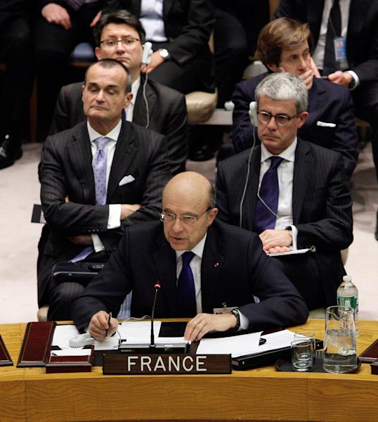 French Foreign Minister Alain Juppe addresses a Security Council meeting at United Nations headquarters, Monday, March 12, 2012. The bloody conflict in Syria is likely to dominate public and private talks Monday as key ministers meet at the United Nations on the Israeli-Palestinian conflict and challenges from the Arab Spring. (AP Photo/Richard Drew)