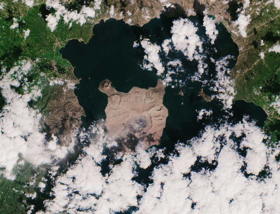 A new satellite view of the Taal volcano that erupted in the Philippines on Jan. 12 reveals an island that is now completely covered in a thick layer of ash. The eruption blasted ash plumes 9 miles (14 kilometers) into the air, and strong winds blew large amounts of ash to neighboring regions, especially the Agoncillo area, visible southwest of the Taal volcano. The European Space Agency's Copernicus Sentinel-2 mission acquired this view of the island on Thursday (Jan. 23).
