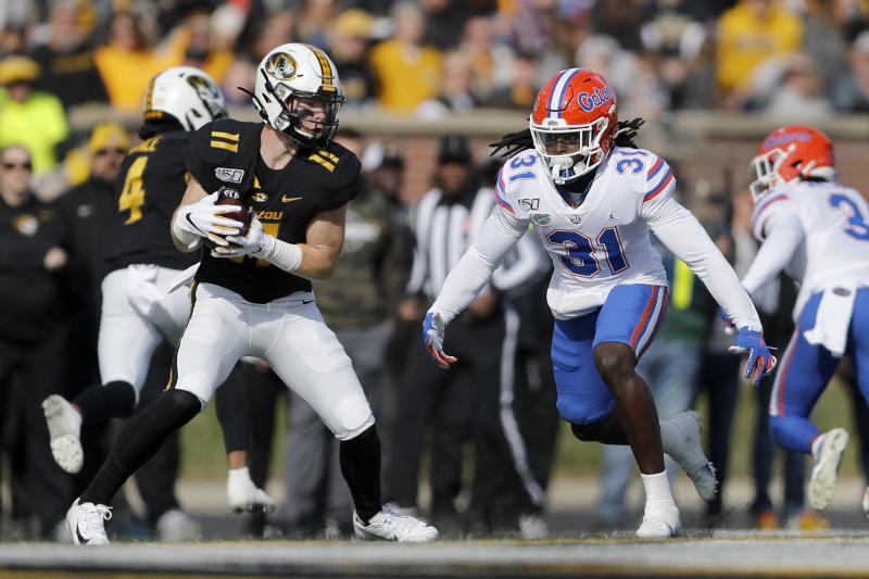 Missouri wide receiver Barrett Banister, left, catches a pass as Florida defensive back Shawn Davis defends during the first half of an NCAA college football game Saturday, Nov. 16, 2019, in Columbia, Mo. (AP Photo/Jeff Roberson)