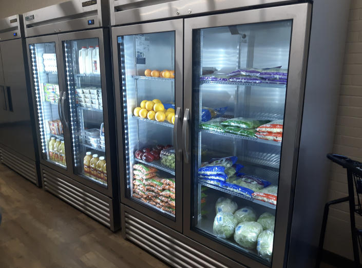 In this photo provided by Paul Juarez, refrigerators are stocked with produce, milk and juice at Linda Tutt High School's student-led grocery store on Nov. 20, 2020, in Sanger, Texas. (Paul Juarez via AP)