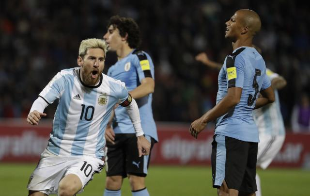 """<a class=""""link rapid-noclick-resp"""" href=""""/soccer/players/lionel-messi"""" data-ylk=""""slk:Lionel Messi"""">Lionel Messi</a> scored in the 43rd minute to give Argentina the lead against Uruguay. (AP Photo)"""