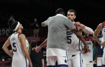 United States's Zachary Lavine (5) hugs teammate Kevin Durant (7) to celebrate after their win in the men's basketball semifinal game against Australia at the 2020 Summer Olympics, Thursday, Aug. 5, 2021, in Saitama, Japan. (AP Photo/Eric Gay)